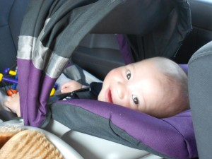 Harlan plays peek-a-boo in the Jeep.